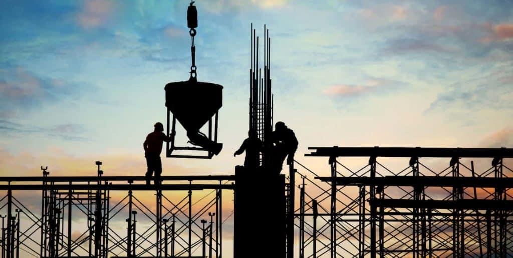 Construction workers pouring concrete